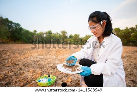 Researchers are checking the soil and collecting soil samples for planting