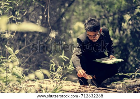researching record data in the forest, Study woods in the asia