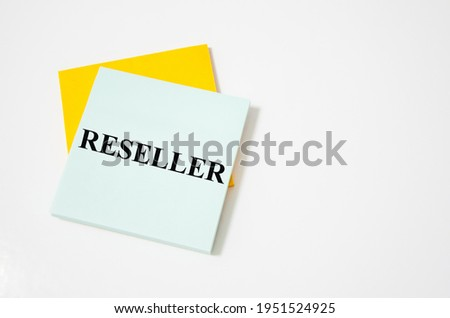 reseller text written on a white notepad with colored pencils and a yellow backgrounds. text Photo stock ©