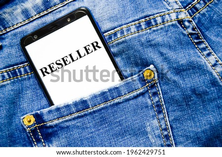 reseller the word is written on the white screen of the phone shortly lies in jeans. text Photo stock ©