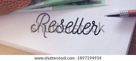 Reseller word on a page of copybook, 100 Euro banknotes and a pen. Sales business concept. Photo stock ©