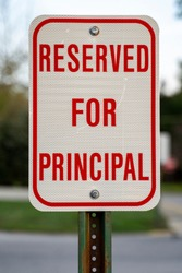 Reserved for Principal Parking Spot and Sign