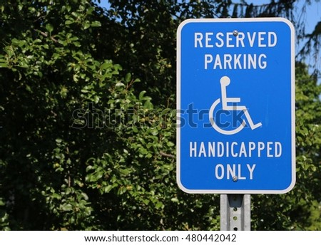 Reserved parking for Handicapped Only sign