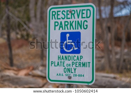 Reserved parking sign handicap plate or permit only symbol traffic driving transportation close up