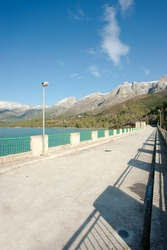 Reservoir dam in sunny winter landscape