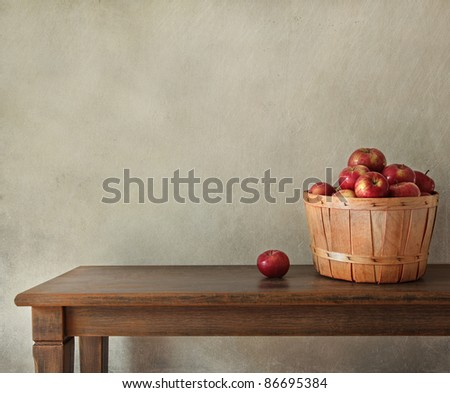 Resh apples on wooden table with lots of copy-space