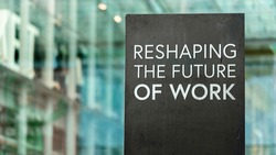 Reshaping the future of work on a city-center sign in front of a modern office building