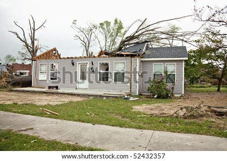 Residence a week after being struck by a tornado.  Some clean up has been completed.