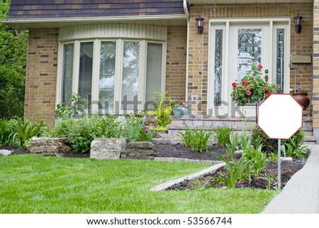residence with blank sign suitable for message for security protection