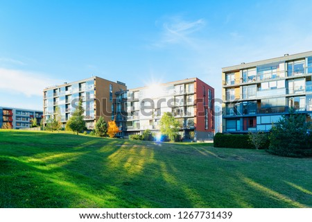 Residential Apartment houses facade architecture with outdoor facilities. Blue sky on the background. With sunlight