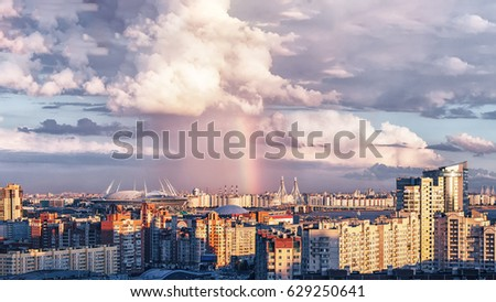 Residential Area Urban View of Primorkiy District in St Petersburg City Russia with Cloudy Rainy Blue Sky and Rainbow on far Horizon on a Evening Sunset #629250641