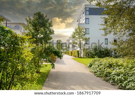 Residential area with ecological and sustainable green residential buildings, low-energy houses with apartments and green courtyard