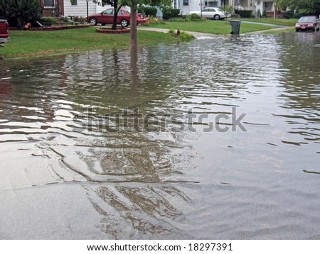 residential city street flooded after heavy rain