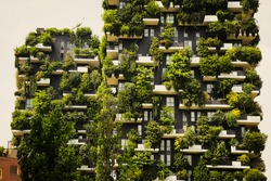 Residential complex in Expo-city of Milan, Italy. View at ecological skyscrapers, terraces with plants. Modern sustainable architecture in Porta Nuova district.
