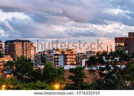 Residential District in Madrid. Arturo Soria Street in Ciudad Lineal. View at sunset Foto stock ©