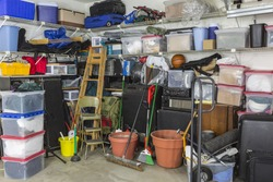 Residential garage full of junk and storage.
