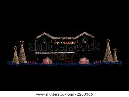 Residential home decorated for the holiday season with lighted trees, bushes, wreaths and candy canes.