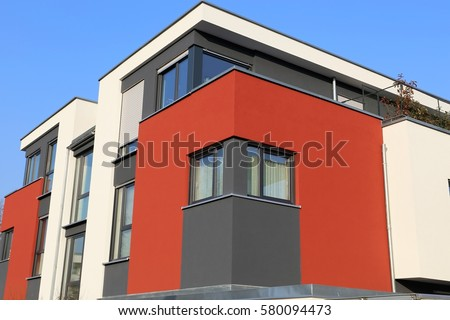 Residential home with modern facade painting #580094473