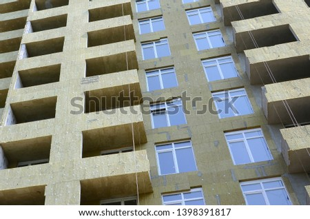 Residential multi store apartement building house facade under construction