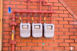 Residential natural gas meter installed on a wall  at Gamcheon Cultural Village in Busan, South Korea.