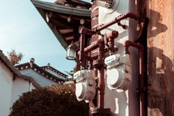Residential natural gas meter installed on a wall in Bukchon Hanok Village in Seoul, South Korea.