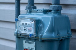 Residential natural gas meter measuring gas consumption.