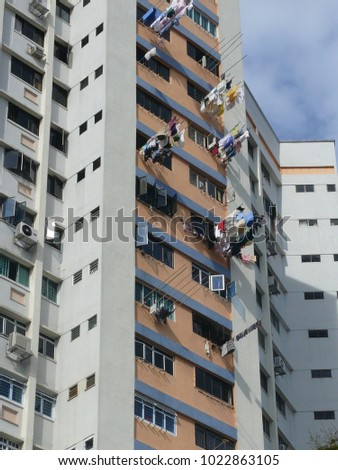 Residential tower with balconies on the balconies bars where the laundry is hung up for drying #1022863105
