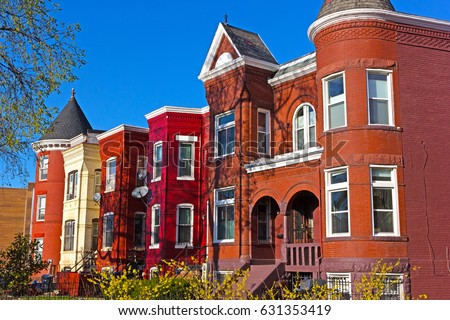Residential townhouses of suburban Washington DC in spring. Colorful urban architecture of Shaw neighborhood in US capital.