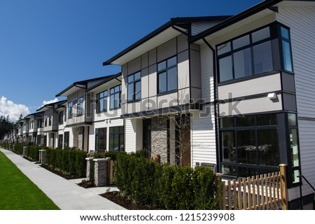 Residential townhouses on blue sky background on sunny day. External facade of a row of colorful modern urban townhouses.brand new houses just after construction on real estate market Сток-фото ©