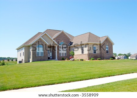 Residential Upscale American House - A residential suburban home in an upscale neighborhood in the summertime.