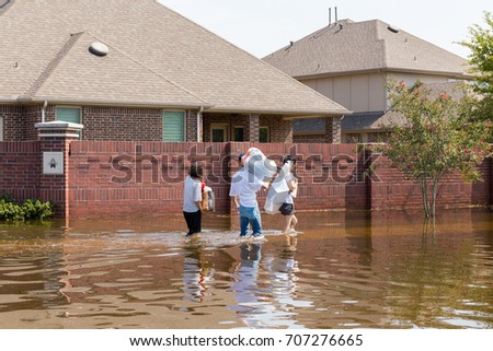 Residents in walk in high waters after devastating floods in Houston suburb