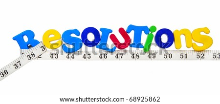 Resolutions written in a colorful mix of plastic letters with a tape measure - concept of weight loss resolution for the new year