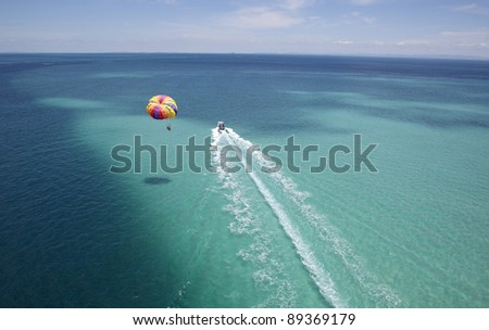 resort activity tropical parasailing