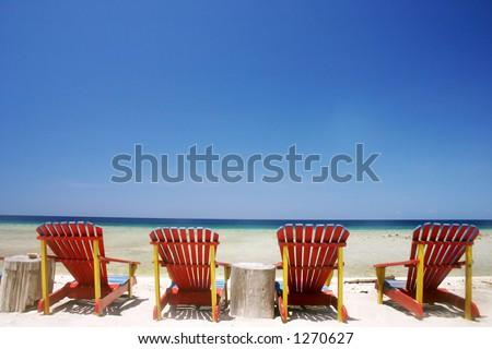 Resort beach chairs at tropical beach