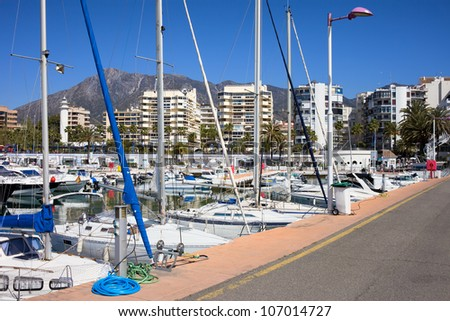 Resort city of Marbella port waterfront, popular vacation destination in southern Spain, Andalucia region, Malaga province.