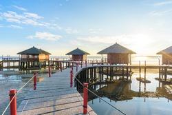 Resort huts built on the sea. Bintan, Indonesia.