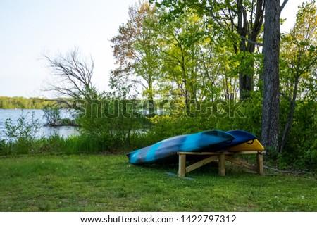 Resort recreational kayaks stacked along Chippewa Foliage #1422797312