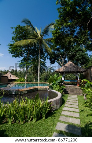 Resort Style Swimming Pool With Small Shack In Tropical Garden ...
