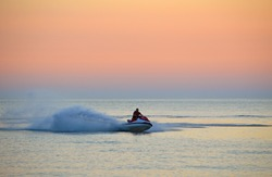Resort vacation. Jet ski in the sea at sunset