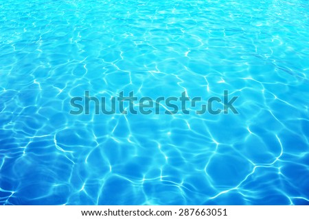 Resort water reflection or water ripple under bright sunny sky.