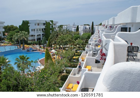Resort with white buildings and a swimmingpool seen on Majorca