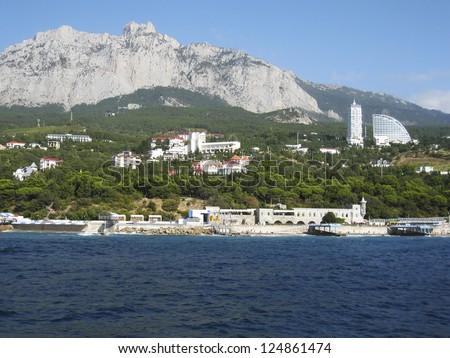 Resourt region Crimea on Black sea, hotels on sea shore and I-Petry hill.