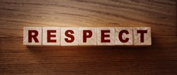 Respect word written on wood block. respect text on table, Business ethics concept.