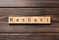 respect word written on wood block. respect text on table, concept.