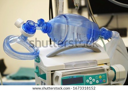 Respiratory mask with resuscitator for ventilation of a patient with pneumonia in the operating room of a hospital
