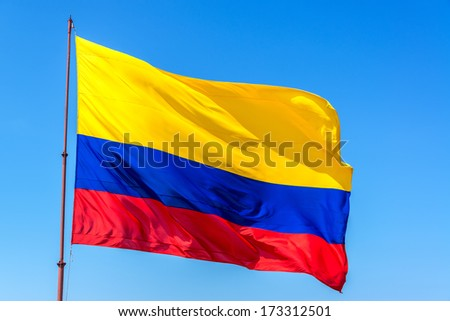 Resplendent Colombian flag waving in the wind set against a beautiful blue sky Stock photo ©