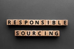 Responsible sourcing - word from wooden blocks with letters, responsible sourcing concept, gray background