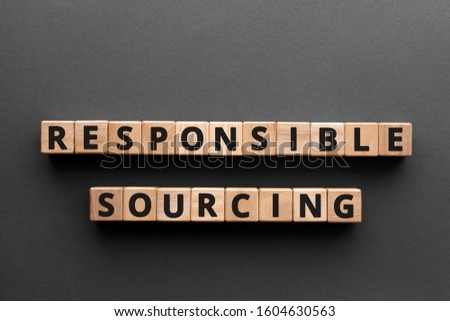Photo of  Responsible sourcing - word from wooden blocks with letters, responsible sourcing concept, gray background