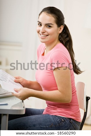Responsible woman opening envelope to pay monthly bills