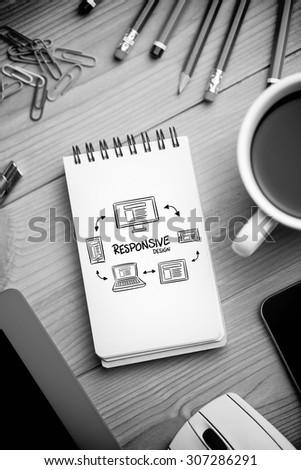 responsive design doodle against notepad on desk